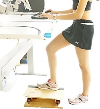 Participant in recent study uses footrest at a standing desk. Image credit: University of Waterloo
