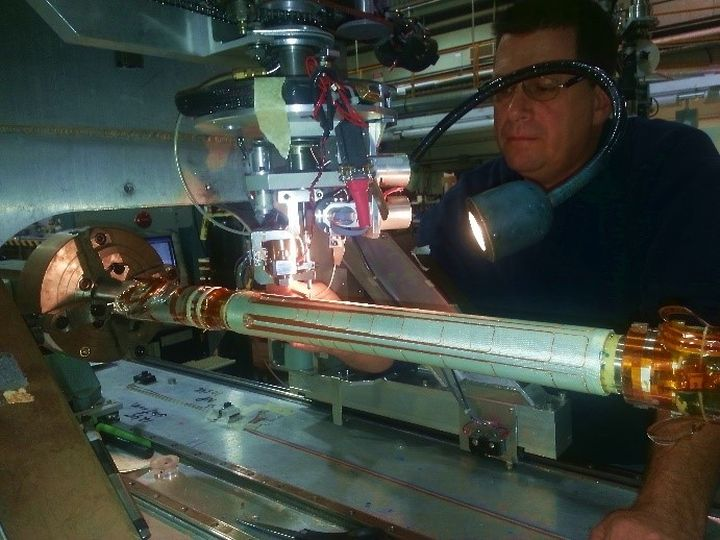 Corrector magnets: Leak field cancel coil being wound by Brookhaven Lab magnet division technician Thomas Van Winckel.