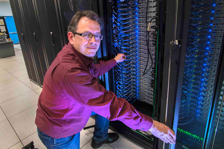 Benedikt Hegner in the Scientific Data and Computing Center at Brookhaven Lab, which stores and processes Belle II data and makes it available to collaborators around the world.