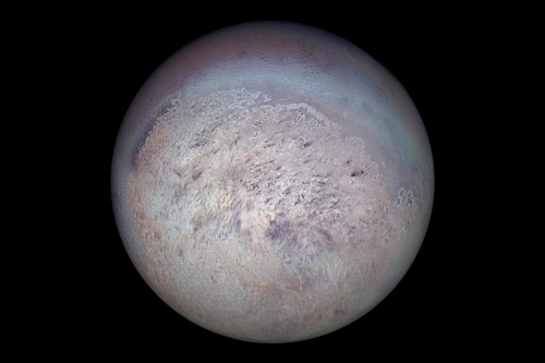 Voyager 2 image of Triton showing the south polar region with dark streaks produced by geysers visible on the icy surface. Credit: NASA/JPL
