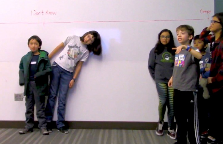 "During some of the design sessions children had to rank real or imagined technologies as ""creepy,"" ""not creepy,"" or ""don't know"" by positioning themselves along a line. Shown here is a screenshot from the research video where most of the children thought the proposed technology — a Pusheen stuffed animal that records your actions and your voice in order to give your parents recommendations about your exercise habits — was creepy. Image credit: University of Washington"