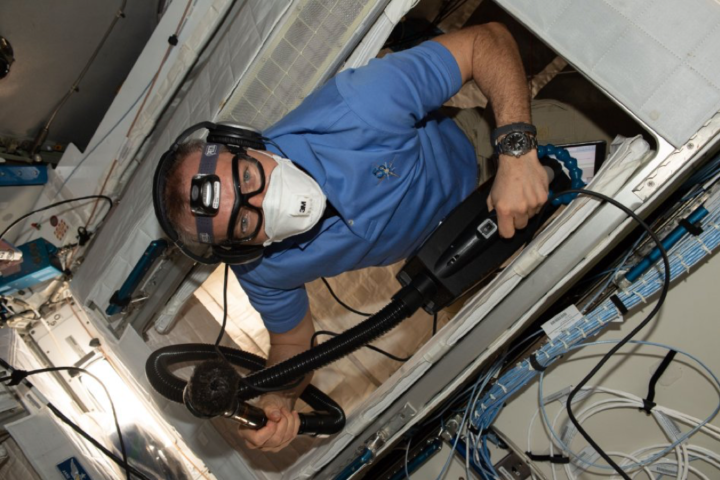 Canadian astronaut David St-Jacques vacuums inside the International Space Station in January 2019. Image credit: Canadian Space Agency