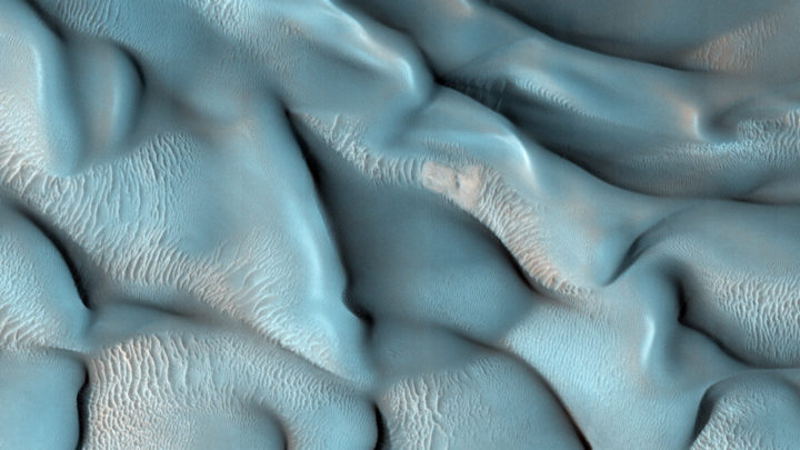 The surface of Mars is covered by constantly shifting sand blown by the planet's winds. This creates an ever-evolving desert landscape with diverse and striking dunes. Loose mounds of sand are found all over Mars, ranging in height from a few dozen feet to higher than some of Earth's tallest skyscrapers. Images taken by the HiRISE instrument aboard NASA's Mars Reconnaissance Orbiter spacecraft have allowed scientists to study Mars' dunes in unprecedented detail. The enhanced-color views captured from orbit reveal characteristics of their shape, composition, and movements over time, giving clues about the planet's dynamic atmosphere and current climate. Credits: NASA/JPL/University of Arizona
