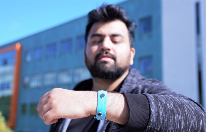 Co-creator Muhammad Umair wearing one of the prototype smart materials wrist bands. Image credit: Paul Turner/Lancaster University