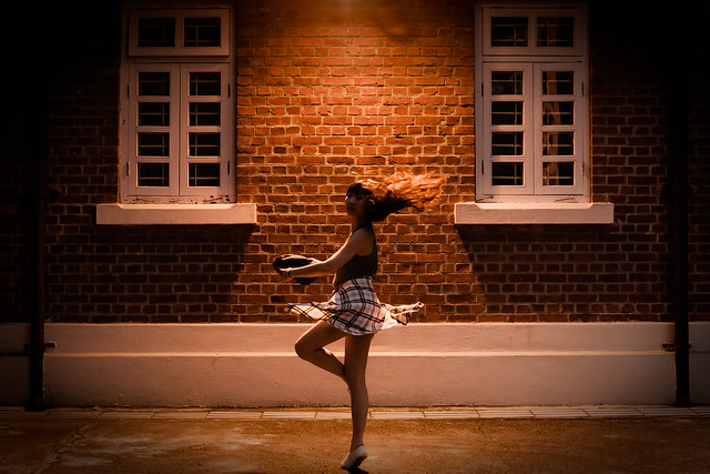 A woman dancing. Image credit: Alan Wat via Flickr, CC BY 2.0