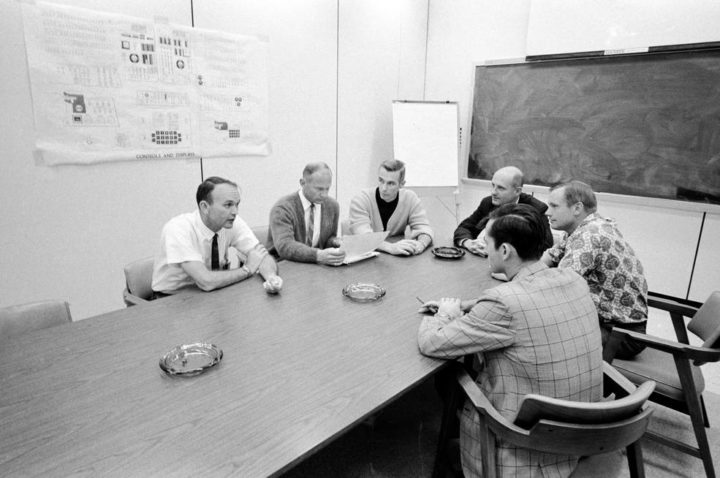 Apollo 10 and 11 astronauts (clockwise from left) Collins, Aldrin, Cernan, Stafford, Armstrong, and Young meet to discuss the lessons learned from the Apollo 10 mission