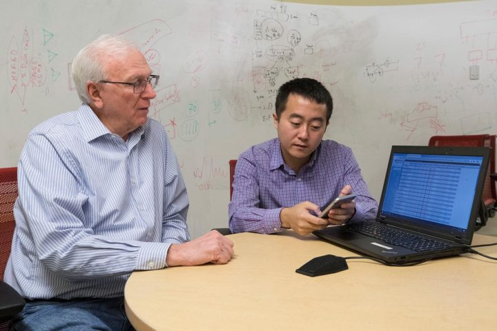 Computer scientists Jack Stankovic, left, and Hongning Wang are developing the system. (Photo by Dan Addison, University Communications)