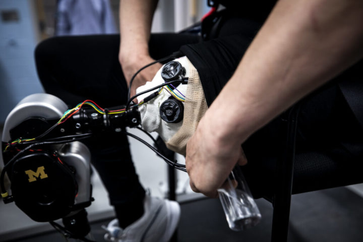 Jordan Musil tests an open-source robotic leg designed by Elliott Rouse, Assistant Professor of Mechanical Engineering, and his research group. Image credit: Joseph Xu, Michigan Engineering