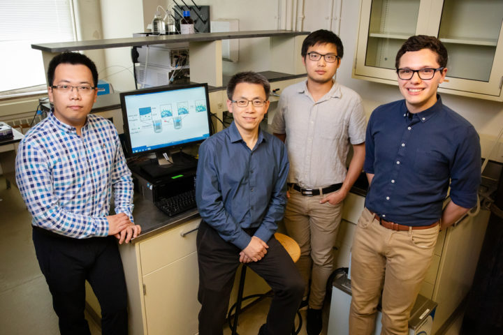 A team including, from left, postdoctoral researcher Ziyuan Song, professor Jianjun Cheng and graduate students Tianrui Xue and Lazaro Pacheco, developed a new method that streamlines the construction of amino acid building blocks that can be used in a multitude of industrial and pharmaceutical applications. Photo by L. Brian Stauffer/University of Illinois