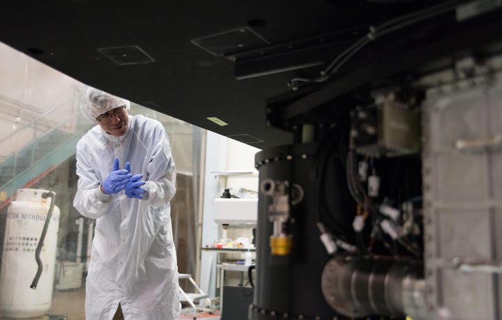 Chris Martin, the principal investigator of the Keck Cosmic Web Imager, inspects the instrument in a clean room at Caltech. Image credit: Caltech