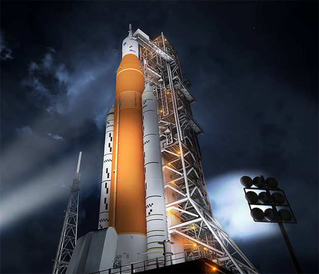 Artist's concept of the Space Launch System rocket and Orion capsule prepared for launch. Credits: NASA