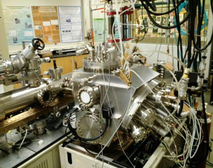 A molecular-beam epitaxy system lays down each atomic layer of the compound in a systematic fashion, so researchers can study the thin layer, or film, structure as they grow it. Image credit: Durbin Lab