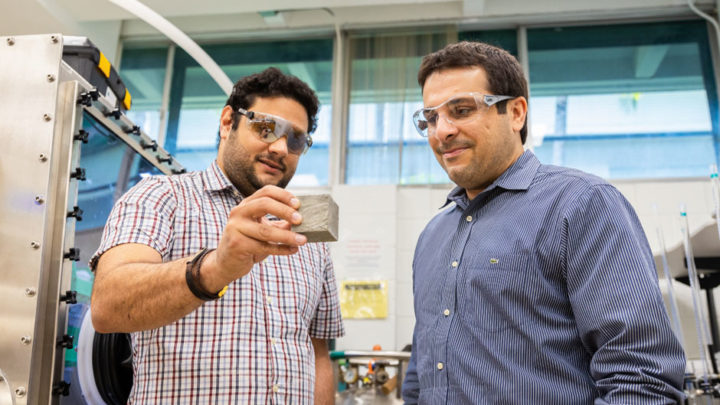 College of Engineering associate professor Ali Ghahremaninezhad (right) is testing different biopolymers to determine which would be most effective in turning lunar soil into a hardened, concrete-type substance. Photo: Evan Garcia/University of Miami