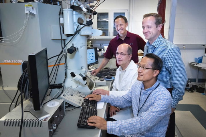 Scientists Myung-Geun Han (sitting front), Ivan Boz̆ović (sitting back), Yimei Zhu (standing back) and Anthony Bollinger of Brookhaven National Laboratory's Condensed Matter Physics and Materials Science Department built electronic transport devices that sandwiched a thin layer of an insulating material between thicker layers of superconducting lanthanum strontium copper oxide (LSCO). In collaboration with scientists at Rice University and the University of Connecticut, the team discovered that a high percentage of electron pairs — which are known to carry superconducting current — exists well above expected temperature and energy ranges in LSCO. (Photo courtesy of Brookhaven National Lab)