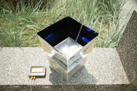 The system helps cool its surroundings by absorbing heat from the air inside the box and transmitting that energy through the Earth's atmosphere into outer space. Image credit: University at Buffalo.