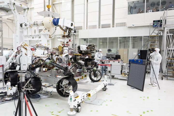 In this image, engineers test cameras on the top of the Mars 2020 rover's mast and front chassis. The image was taken on July 23, 2019, in the Spacecraft Assembly Facility's High Bay 1 at NASA's Jet Propulsion Laboratory in Pasadena, California. Credit: NASA/JPL-Caltech.