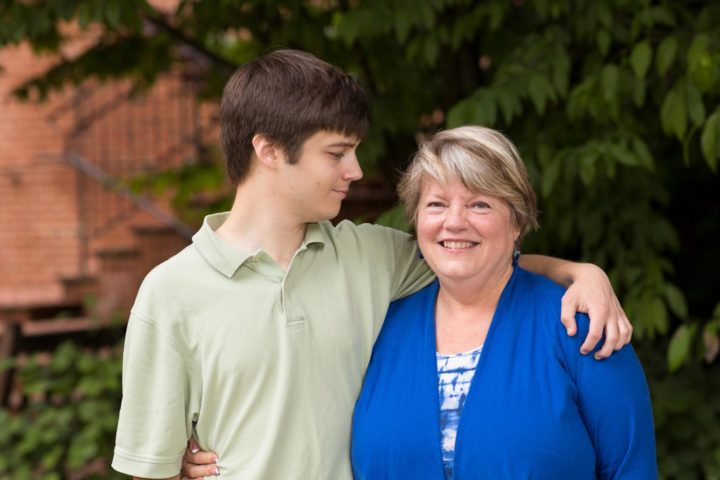 Fay Painter's son Adam, 22, was diagnosed with autism at age 3. Now, as a family resource navigator, Painter provides support and guidance to local families with a new diagnosis. (Photo by Dan Addison, University of Virginia)