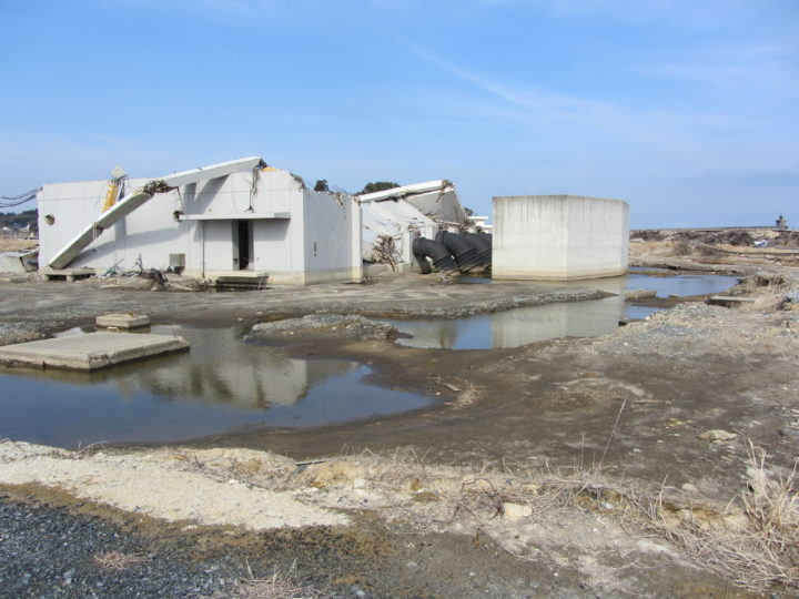 A scene following the 2011 Heisei Tsunami in Idagawa, Fukushima, Japan, showing destruction of a reinforced-concrete structure and severe scour surrounding the structure. (Photo courtesy OSU College of Engineering)