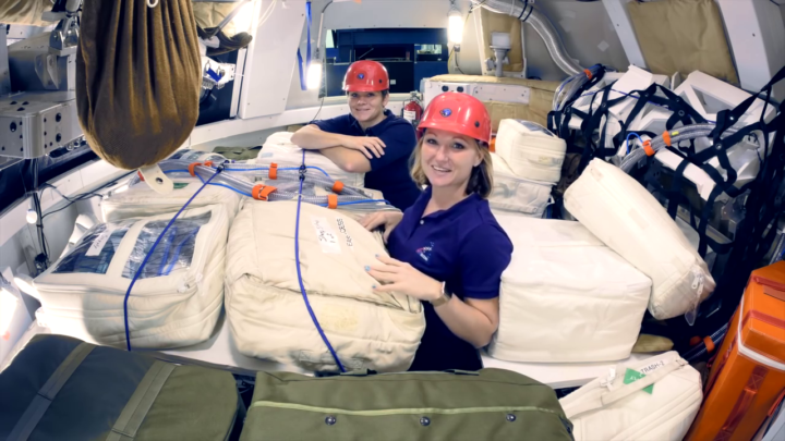 Jessica Vos (foreground), deputy health and medical technical authority for Orion, and astronaut Anne McClain (background) demonstrate the radiation protection plan in a representative Orion spacecraft. During an SEP event, the crew will use stowage bags on board Orion to create a dense shelter from radiation. Credits: NASA