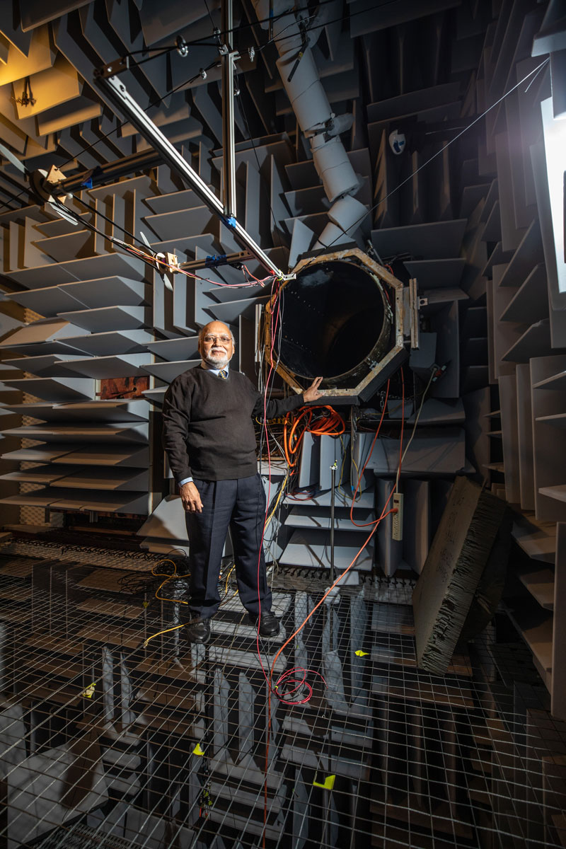 Krish Ahuja in a sound-insulated chamber. During his early research, he remained in the chamber to observe the jet from a position just below the wire grid he is standing on. Photo: Branden Camp / GTRI.
