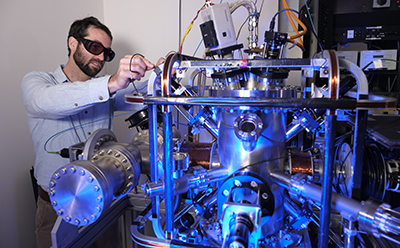 University of Adelaide researcher Dr Rohan Glover with the Atom Trap Trace Analysis (ATTA) facility at the Institute for Photonics and Advanced Sensing, University of Adelaide