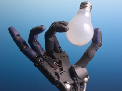 Robotic hand holding a bulb.