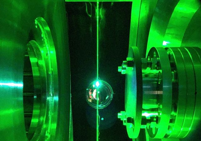 Scientists use a laser to align the plasma created at the Proto-MPEX machine at ORNL. Credit: Ted Biewer/Oak Ridge National Laboratory, U.S. Dept. of Energy
