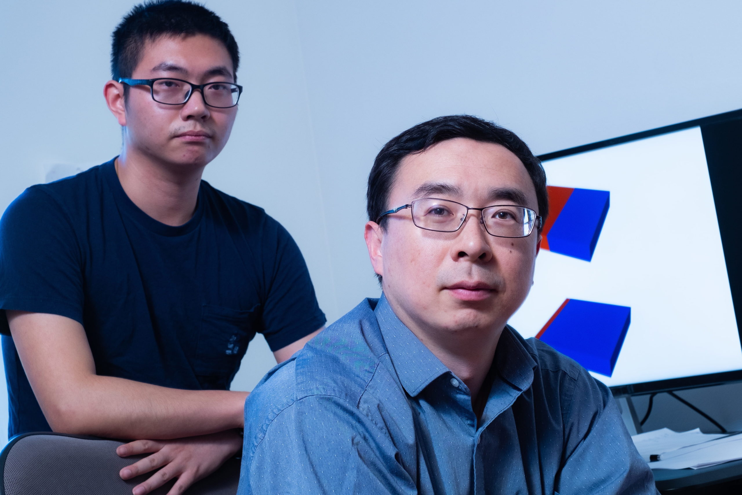 Rice University graduate student Kaiqi Yang, left, and materials scientist Ming Tang modeled how engineering defects in the atomic lattice of an iron phosphate cathode can improve the performance of lithium ion batteries. (Credit: Jeff Fitlow/Rice University)