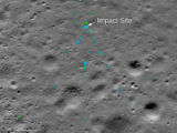 """This image shows the Vikram Lander impact point and associated debris field. Green dots indicate spacecraft debris (confirmed or likely). Blue dots locate disturbed soil, likely where small bits of the spacecraft churned up the regolith. """"S"""" indicates debris identified by Shanmuga Subramanian. This portion of the Narrow Angle Camera mosaic was made from images M1328074531L/R and M1328081572L/R acquired Nov. 11. Credits: NASA/Goddard/Arizona State University."""