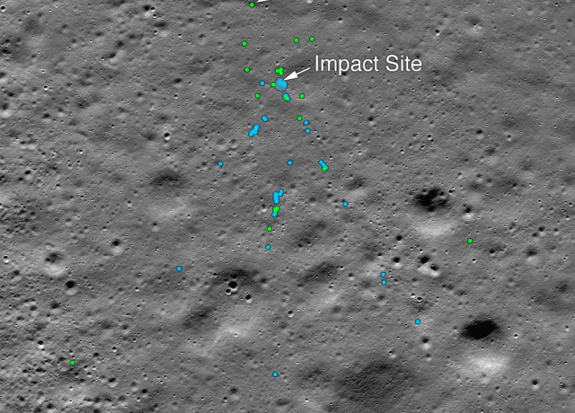 "This image shows the Vikram Lander impact point and associated debris field. Green dots indicate spacecraft debris (confirmed or likely). Blue dots locate disturbed soil, likely where small bits of the spacecraft churned up the regolith. ""S"" indicates debris identified by Shanmuga Subramanian. This portion of the Narrow Angle Camera mosaic was made from images M1328074531L/R and M1328081572L/R acquired Nov. 11. Credits: NASA/Goddard/Arizona State University."